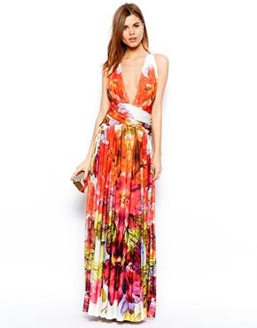 Maxi robe à encolure plongeante et imprimé à fleurs tropicales 309,01 € Forever Unique sur Asos